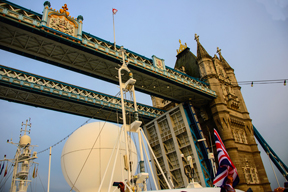 Silver Cloud passes beneath the Tower Bridge in London