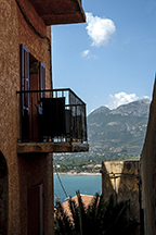 Climbing the fortress walls for a view of the port of Calvi
